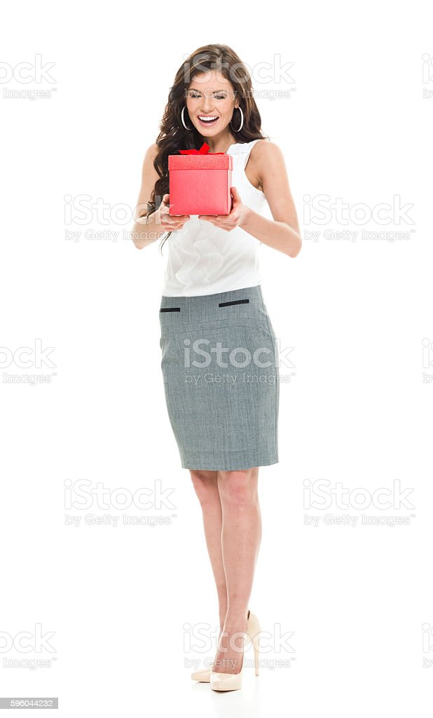 Cheerful businesswoman holding gift box royalty-free stock photo