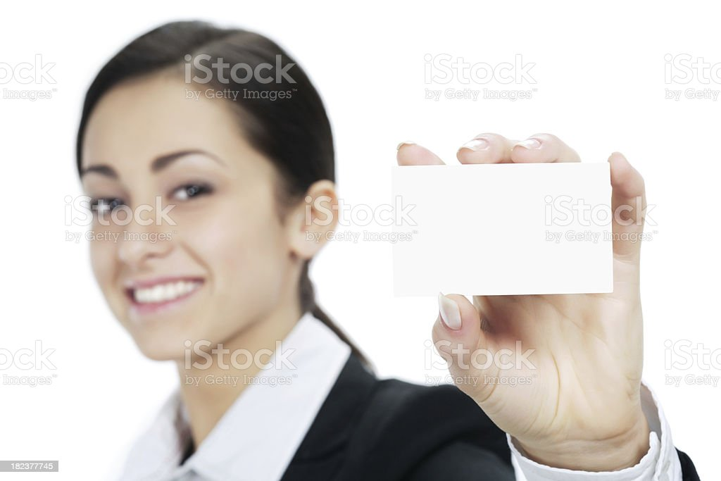 Cheerful businesswoman holding out a card (focus on it) royalty-free stock photo