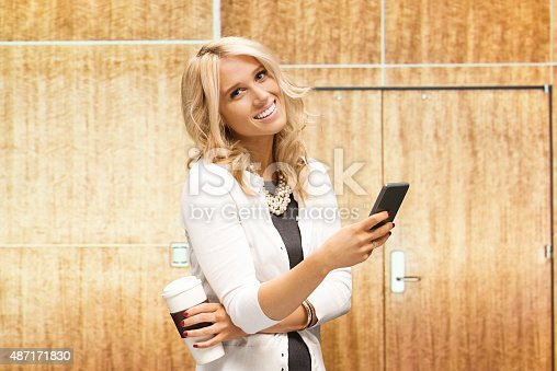 istock Cheerful businesswoman in office 487171830