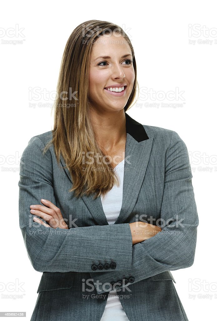 Cheerful businesswoman looking away stock photo