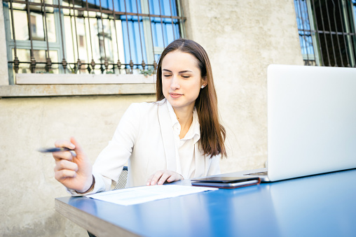 istock Cheerful Businesswoman Reading Documents 468386182
