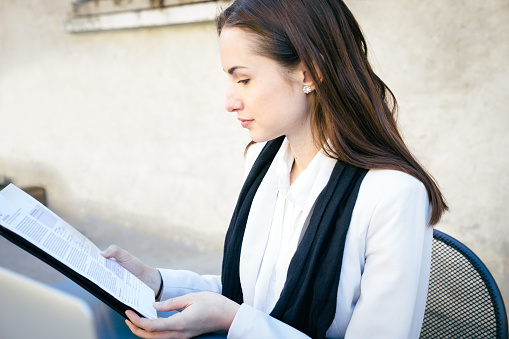 istock Cheerful Businesswoman Reading Documents 468386192