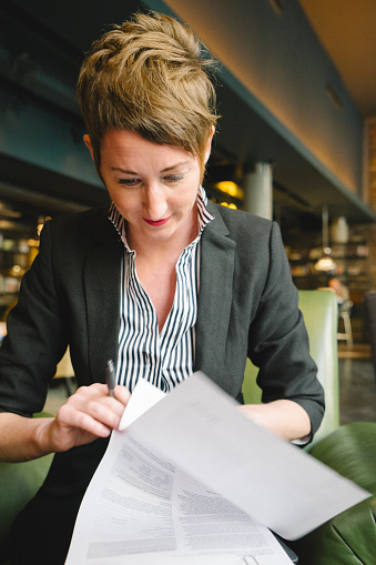 istock Cheerful Businesswoman Reading Documents 472863852