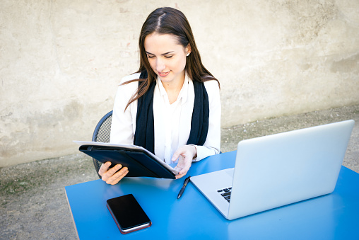 istock Cheerful Businesswoman Reading Documents, Smiling 468386176