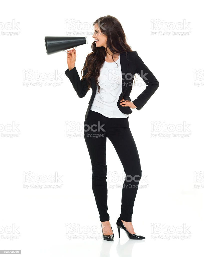 Cheerful businesswoman shouting with megaphone royaltyfri bildbanksbilder