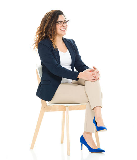 cheerful businesswoman sitting on chair - sitting stock pictures, royalty-free photos & images