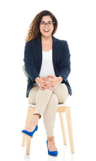 Cheerful businesswoman sitting on chair
