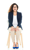 Cheerful businesswoman sitting on chair