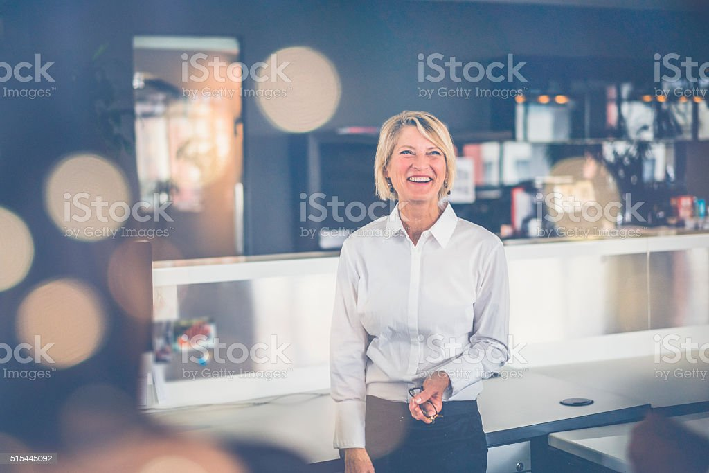 Cheerful businesswoman standing in office royalty-free stock photo