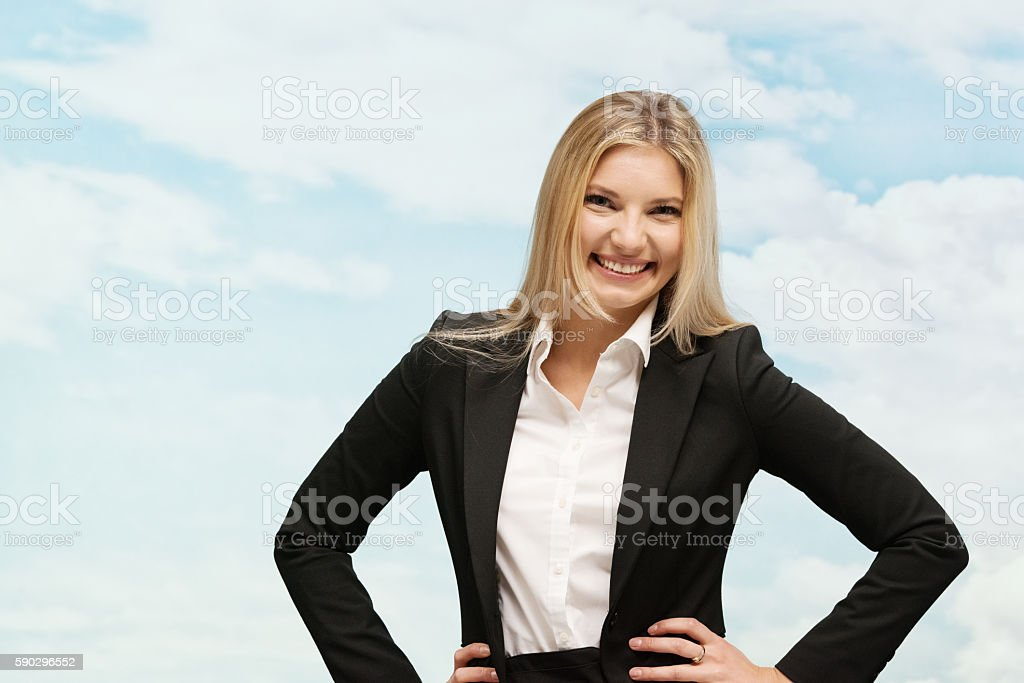 Cheerful businesswoman standing royaltyfri bildbanksbilder