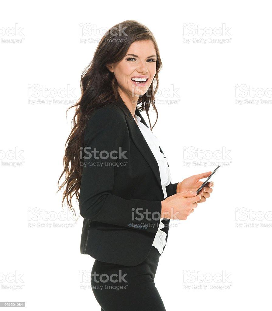 Joyeuse femme d'affaires à l'aide de téléphone photo libre de droits