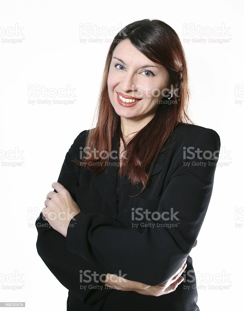 Cheerful businesswoman with crossed arms royalty-free stock photo
