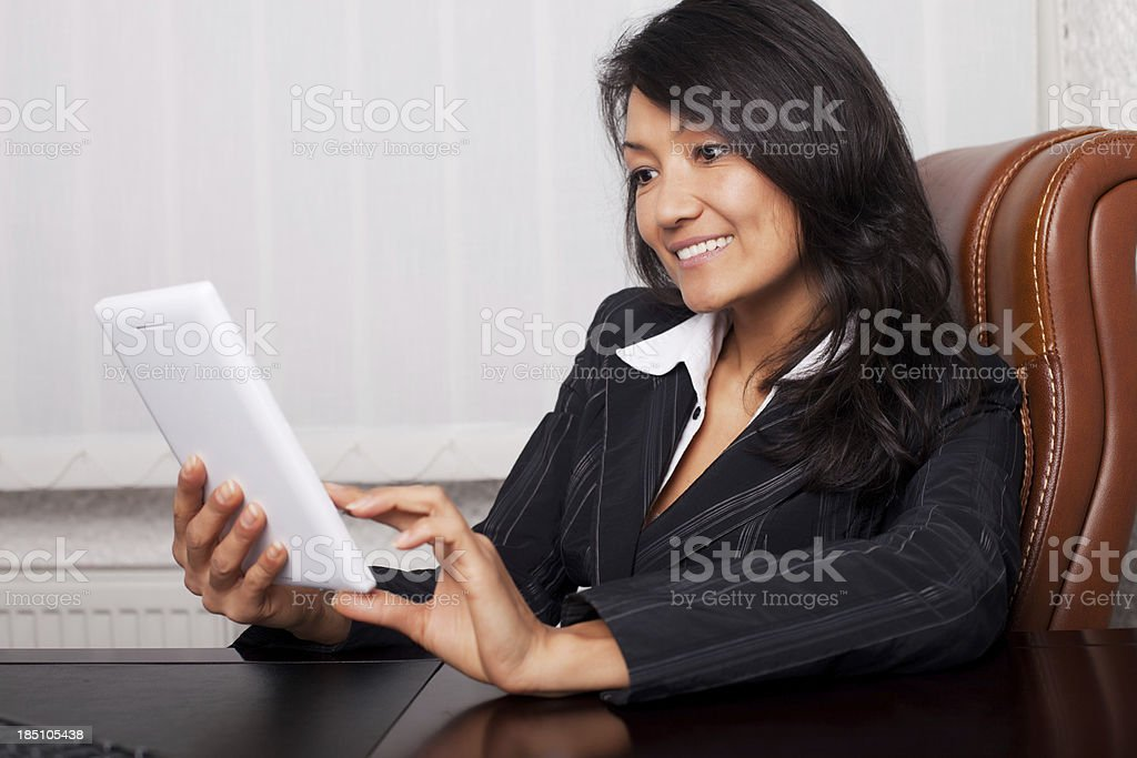 Cheerful businesswoman with digital tablet. royalty-free stock photo
