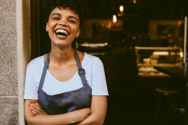 Cheerful cafe owner stock photo