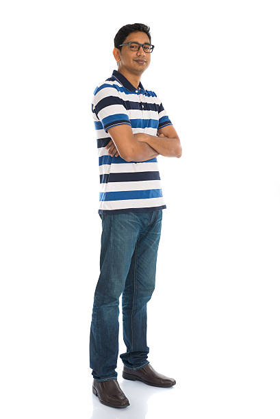 cheerful casual indian man full body isolated on white stock photo