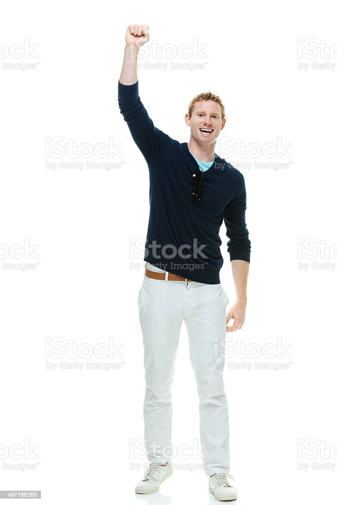 Cheerful casual man cheering stock photo