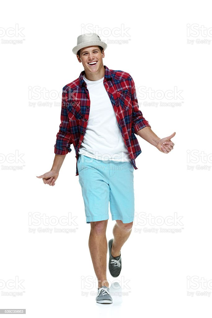 Cheerful casual man showing thumbs up royalty-free stock photo