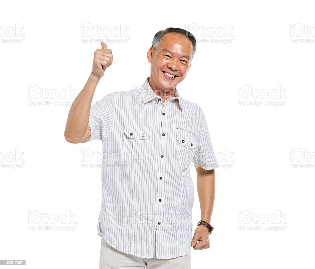 Cheerful Casual Old Man Giving a Thumbs Up stock photo