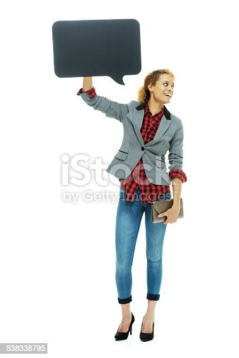1128272390 istock photo Cheerful casual woman holding speech bubble 538338795