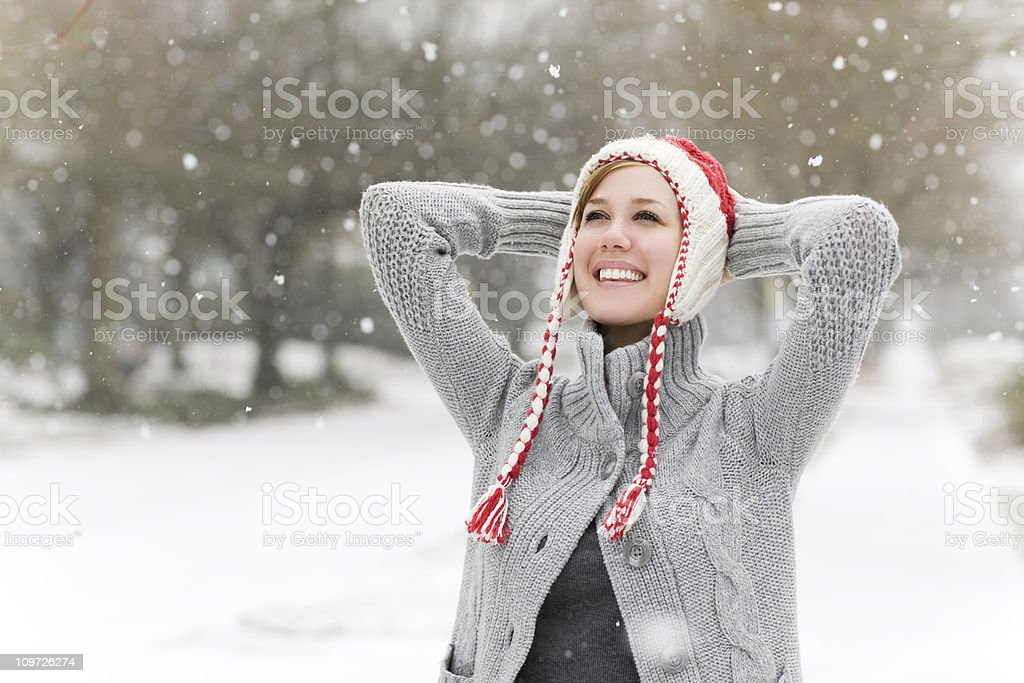 Cheerful Caucasian Young Woman in Snowy Weather, Copy Space stock photo