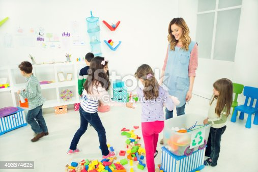 544351868 istock photo Cheerful Children Learning About Recycling in a kindergarden. 493374625