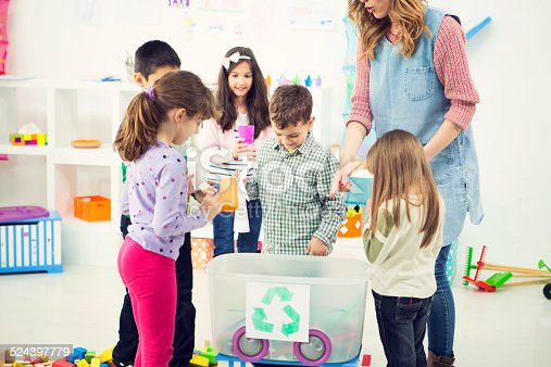 544351868 istock photo Cheerful Children Learning About Recycling in a kindergarden. 524397779
