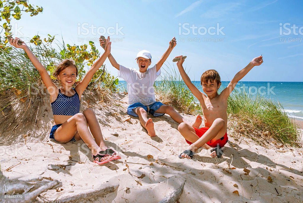 Cheerful children on the shore of Lake Michigan, Indiana, USA stock photo