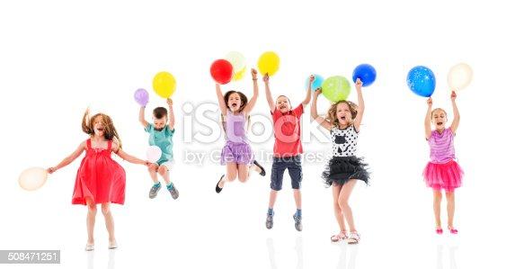 istock Cheerful children with balloons. 508471251