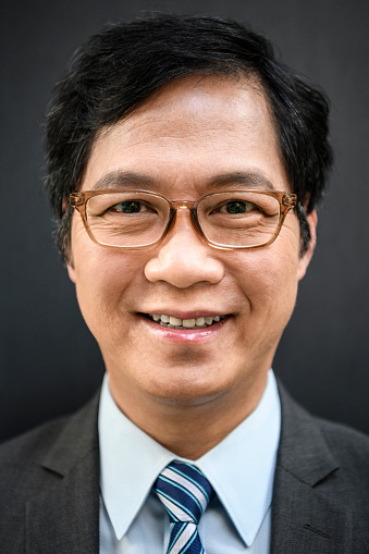 825083248 istock photo Cheerful Chinese businessman in glasses smiling 1200064763