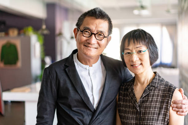 Cheerful Chinese couple at home stock photo