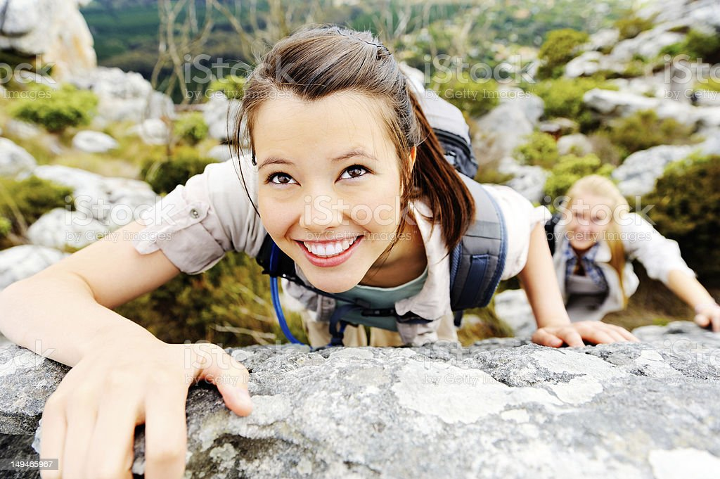 cheerful climbing woman royalty-free stock photo