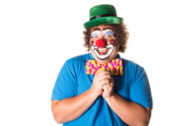 Young man in clown makeup stock photo. Image of blue