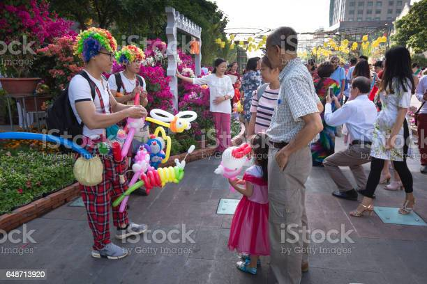 A Cheerful Clown Selling Balloons On Street In Lunar New Year Stock Photo - Download Image Now
