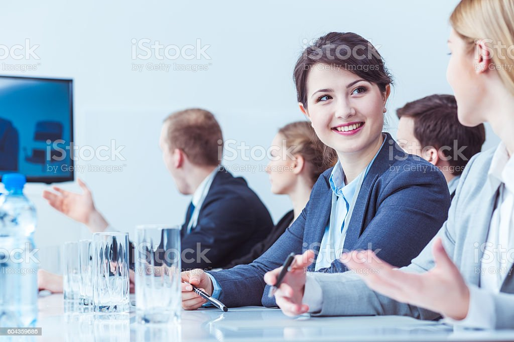 Cheerful colleagues from the same department stock photo