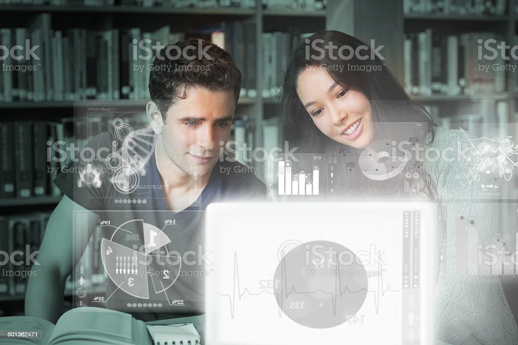 Cheerful college friends studying on digital interface stock photo