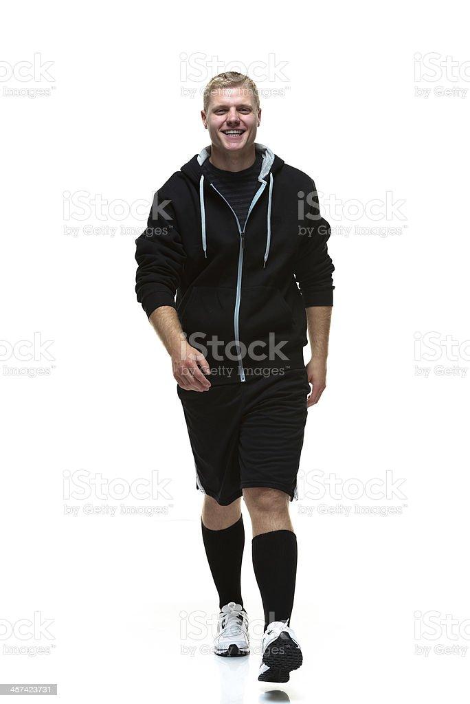 Cheerful college student walking stock photo