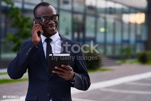 istock Cheerful confident African-American businessman outdoors 891835622
