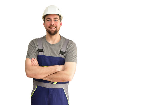 cheerful construction worker - craftsman in work clothes on white background - insulated stock photo