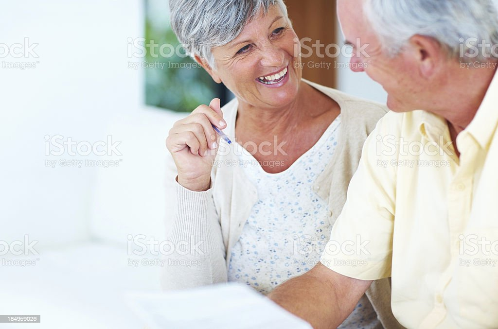 Cheerful couple calculating house bills royalty-free stock photo