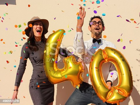 istock Cheerful couple celebrates a forty years birthday 496553978