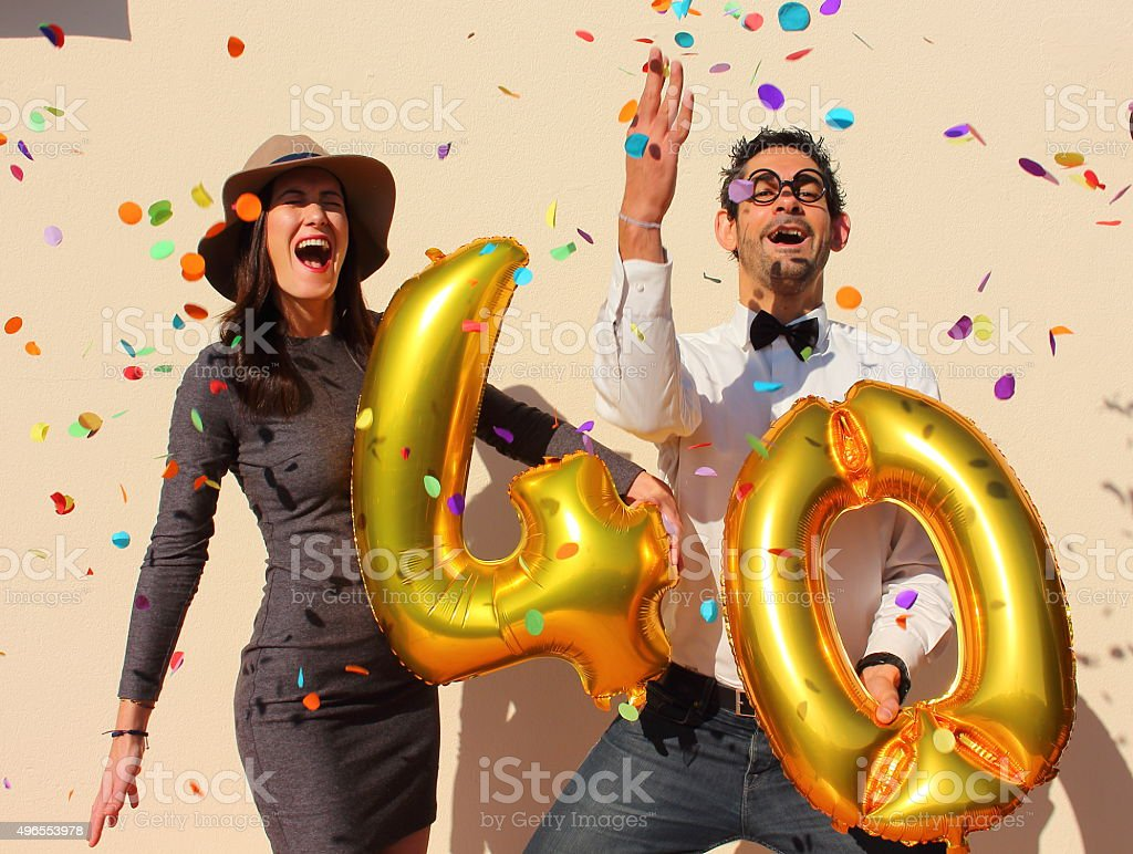 Cheerful couple celebrates a forty years birthday stock photo
