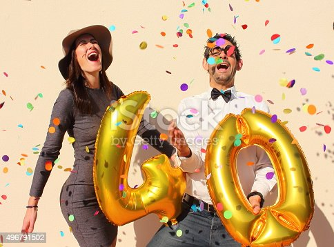 istock Cheerful couple celebrates a forty years birthday 496791502