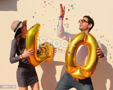 istock Cheerful couple celebrates a forty years birthday 498547188