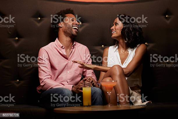 Cheerful couple conversing on sofa at nightclub picture id522732725?b=1&k=6&m=522732725&s=612x612&h=xynv xh2jlbdgtnbjhlapnozeohr9b yr2n036vb9qo=