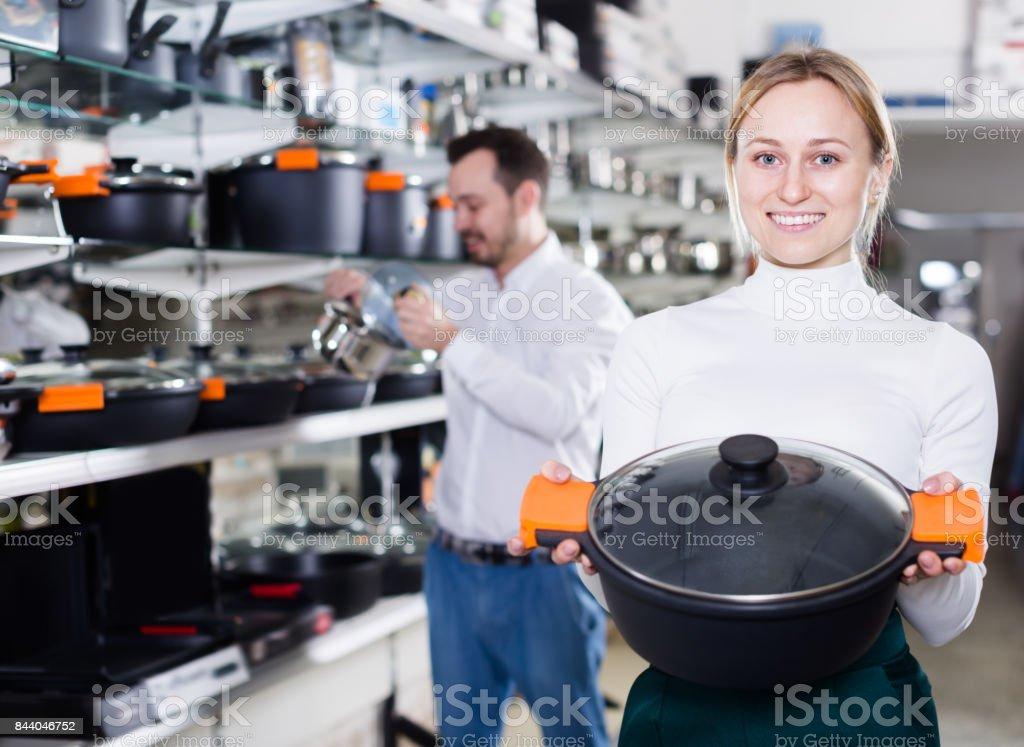Cheerful couple deciding on best saucepan stock photo