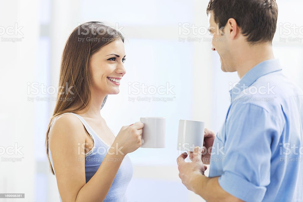 Cheerful couple drinking morning coffee. royalty-free stock photo