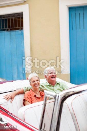 108329737 istock photo Cheerful couple enjoying a car ride in Cuba 186804126