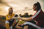 istock A cheerful couple enjoying alcohol during a picnic, on a summer day and sunset 1249028531