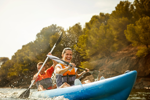Cheerful couple enjoying kayaking