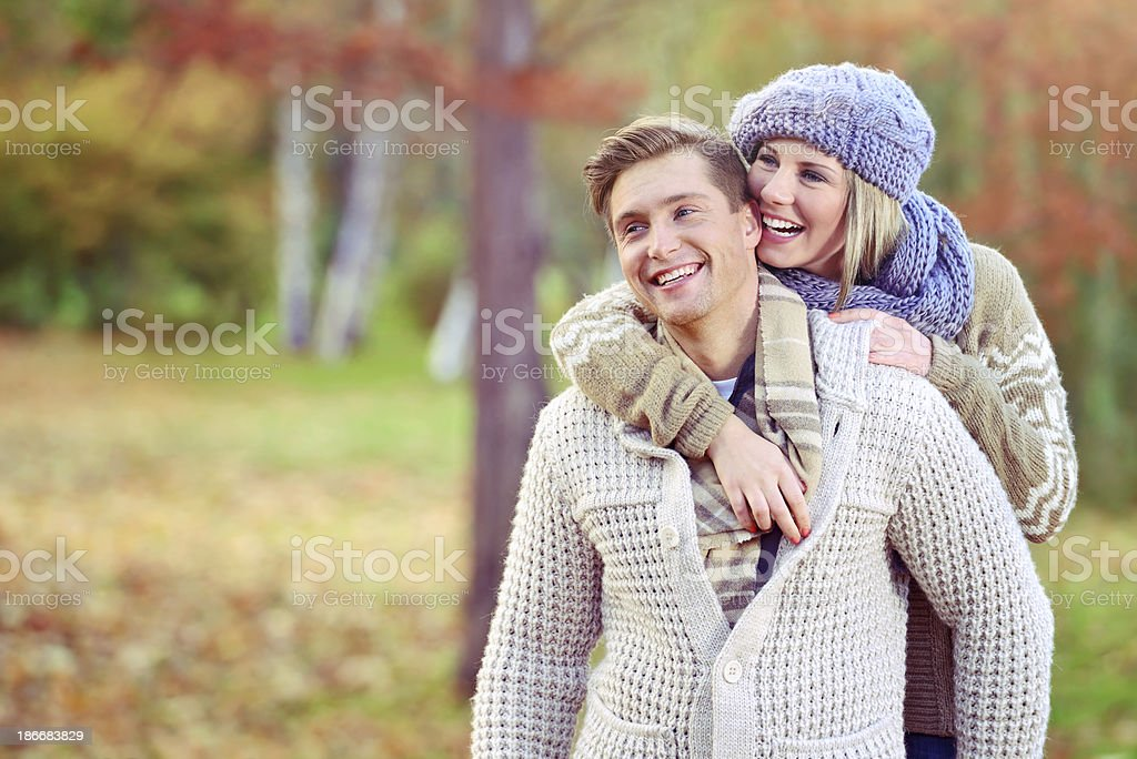 Cheerful couple enjoying outdoors in an autumn day at park royalty-free stock photo
